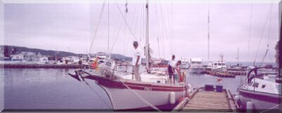 Peter Watkins' Bayfield 32 at the Lewisporte Marina with the skipper on the bow