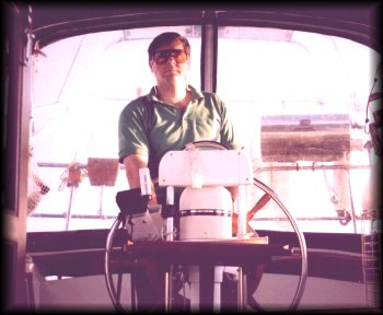Me at the helm of Windborne in 1997